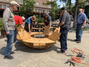Men's Shed helping to build the wooden garden sphere.