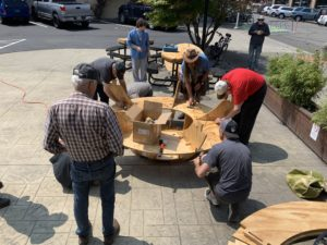 Placing the first wooden pieces to build the first layer of the garden sphere