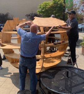 Cooperatively placing circular shelves on the top layer of the garden sphere